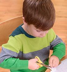 Small Cute Boy Cutting with Scissors_edi