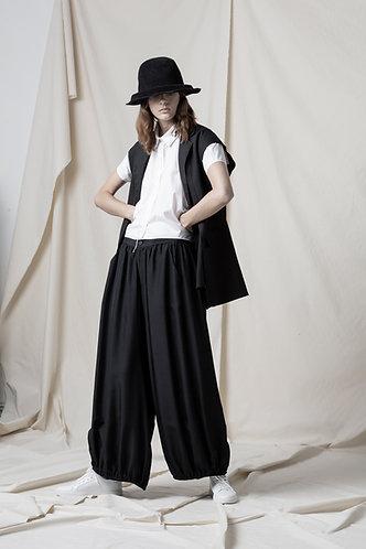 Asymmetric vest with hand stitch