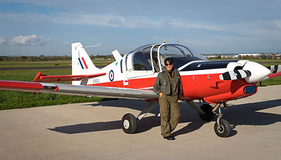 Aviation and formation flight photographer Su Khoo standing by a Scottish Aviation Bulldog aircraft