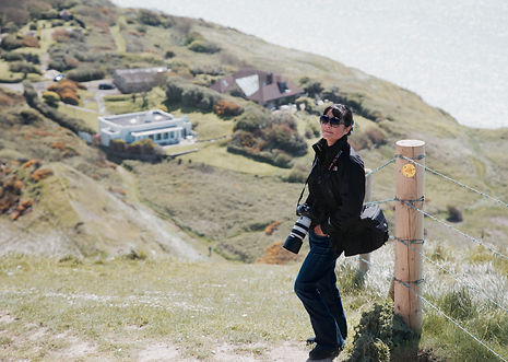 Su Khoo on holiday on the Devon Dorset coast with her camera