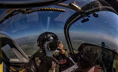 Aviation photographer Su Khoo in flight shooting from Scottish Aviation Bulldog