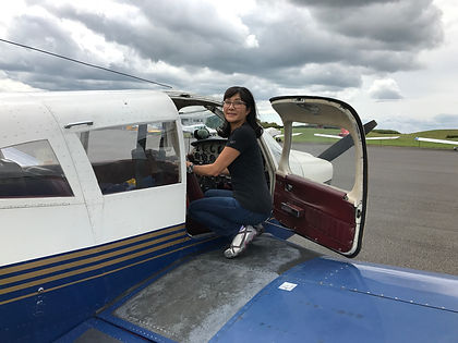 Aviation photographer Su Khoo getting out of a Piper PA28 Cherokee at Turweston Aerodrome on her PPL qualifying cross country flight