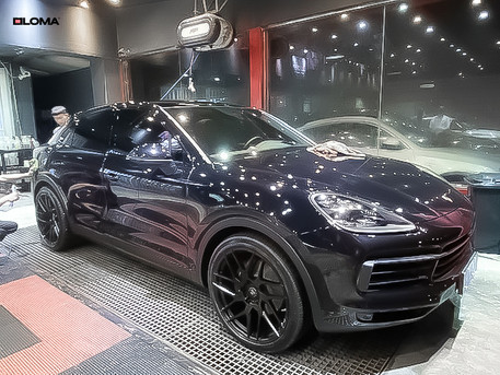 black-24-inch-rims-porsche-cayenne-coupe-front-side