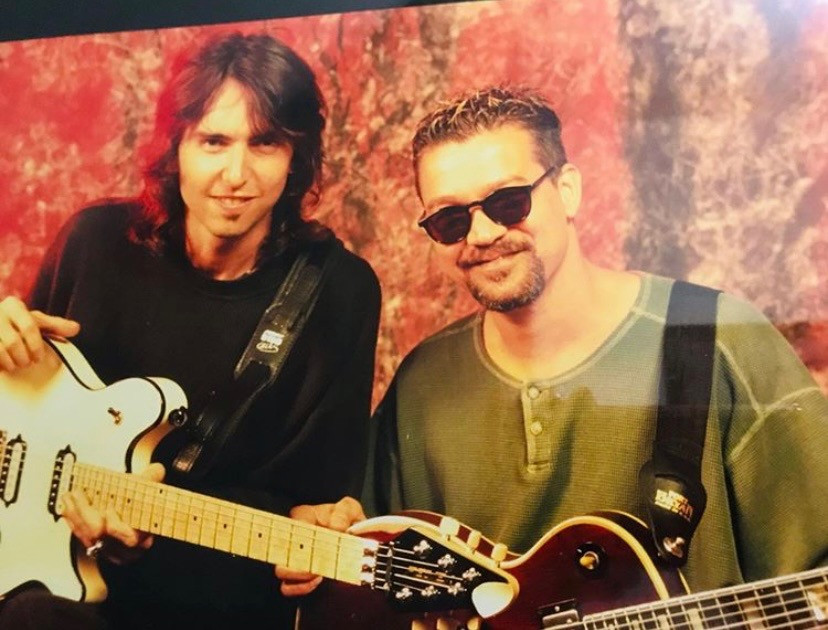 Damon Johnson with Eddie Van Halen, both holding guitars.