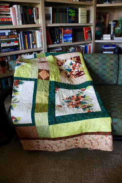 Quilt with vintage tablecloth