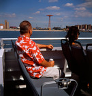 038_L_MAN ON BOAT LOOKING AT CONEY ISLAN