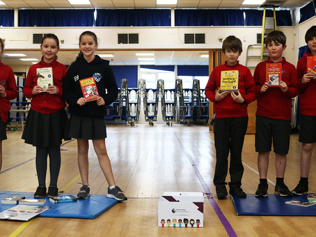 To celebrate World Book Day, Bristol Rovers distribute free books to local primary school pupils