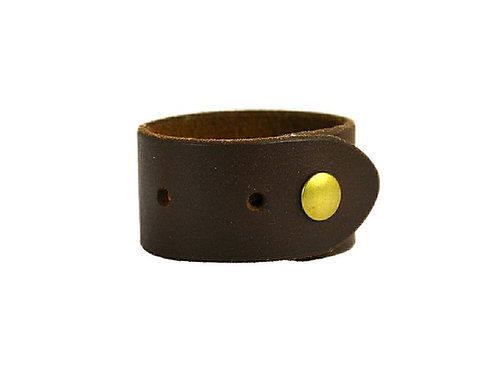 "1.5 "" cuff, Hole punch. Available black or brown"