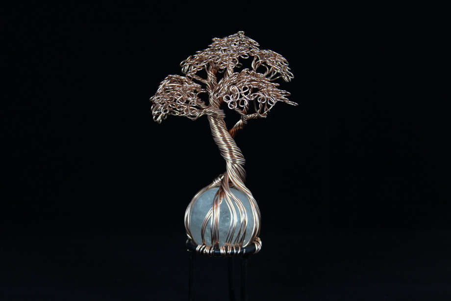 Copper tree sculpture on quartz