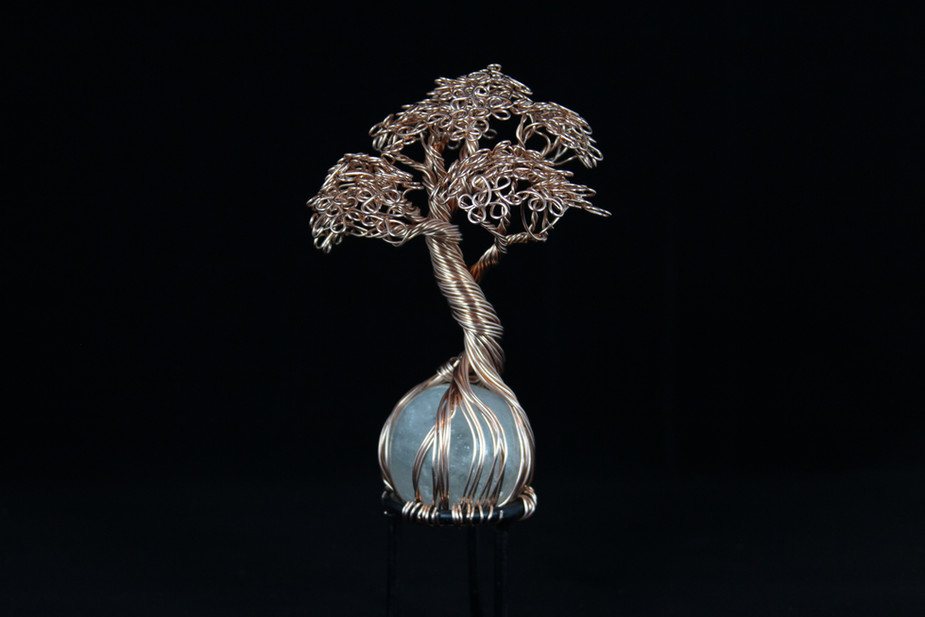 Copper tree sculpture on quartz