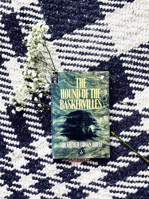 The Hound of Baskervilles by Sir Arthur Conan Doyle (a Sherlock Holmes novel)