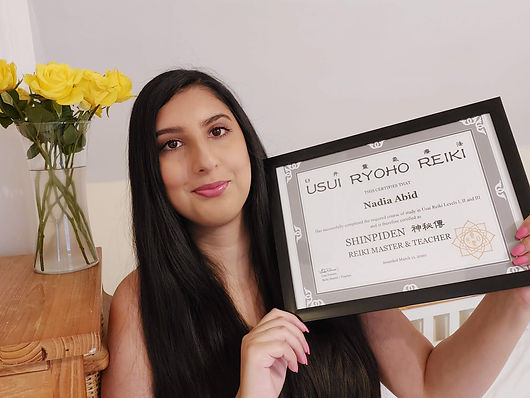 person holding Reiki certificate.