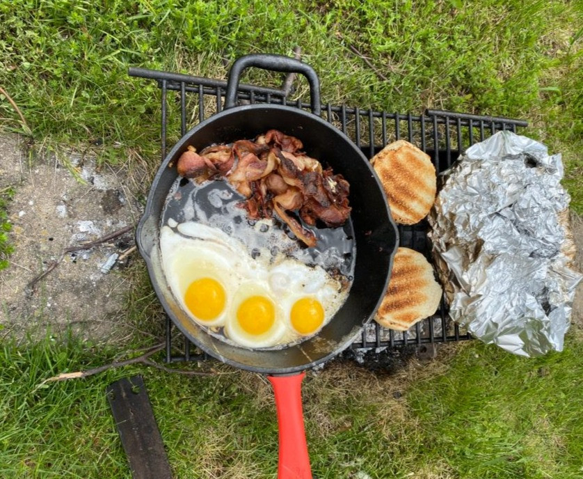 Cooking breakfast in cast iron over an open flame