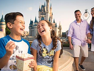 family laughing disney castle.jpg