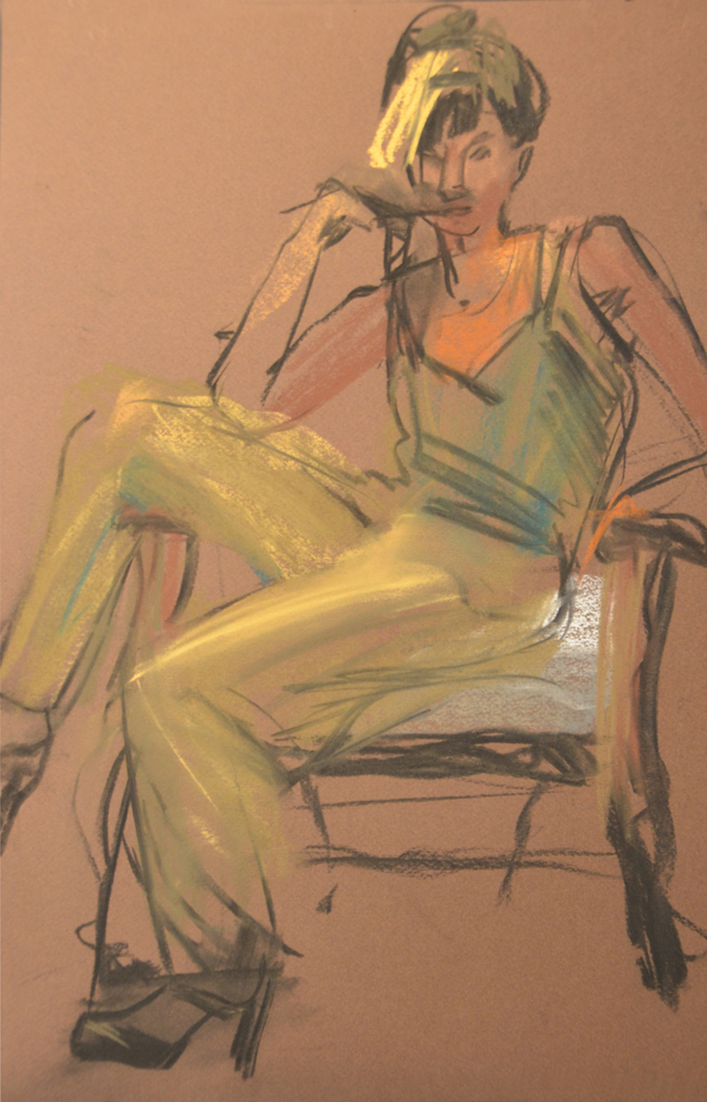 Seated in yellow pants