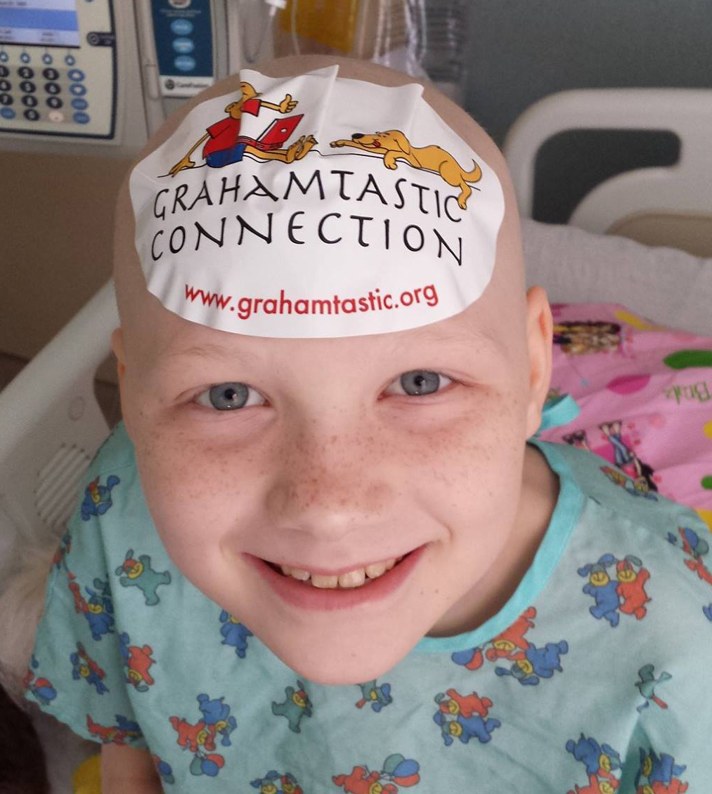 Child with Sticker on Head