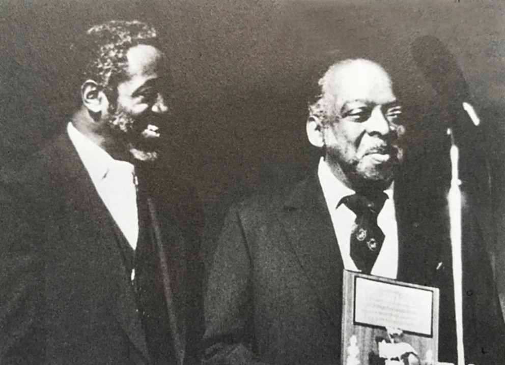 Jimmy Cheatham presenting an award to Count Basie at a UCSD concert.