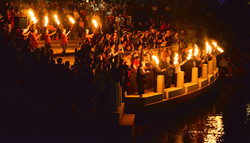 torch-bearers-prepare-to-light-the-waterfire-guest-lighters-on-the-boats-who-lit-the-brazier-for-the