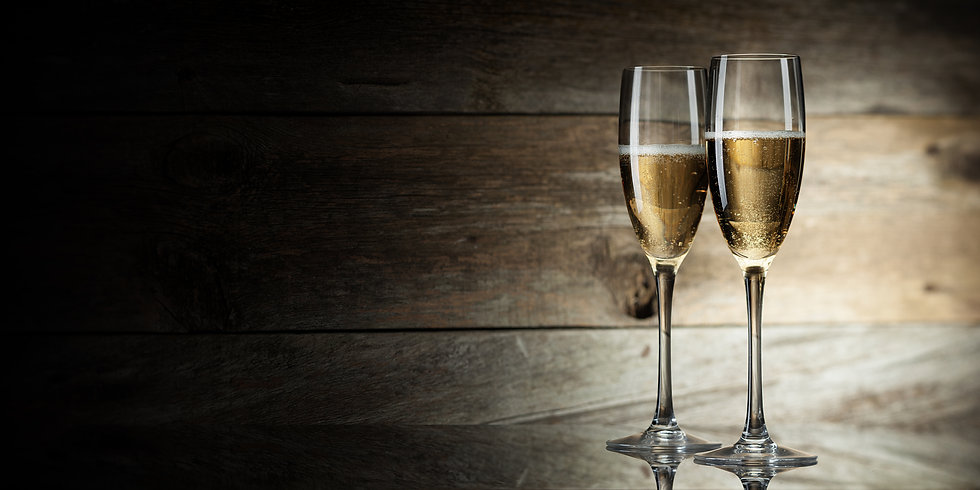 two glass with champagne on a wooden bac