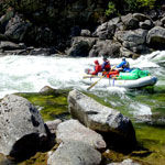 Idaho-Whitewater-Rafters-dropping-in.jpg