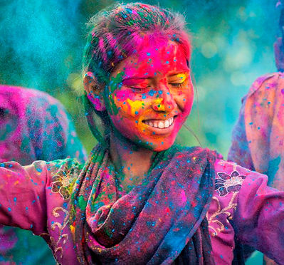 woman-dancing-in-colourful-powder-at-hol