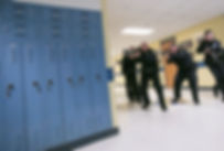 police in school hallway lockers.jpg
