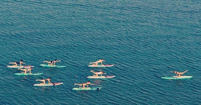 Sup yoga di gruppo