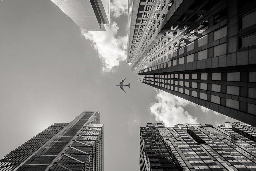 low-angle-greyscale-shot-airplane-flying