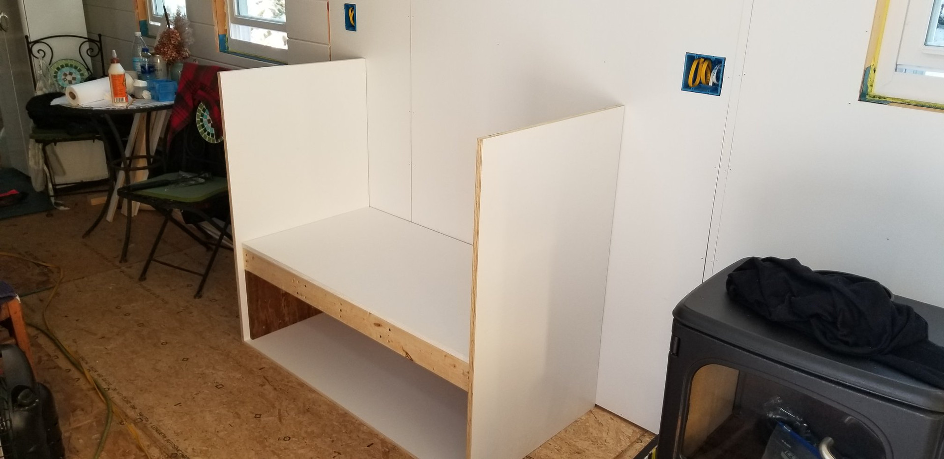Before non-combustible walls are put on the stove unit