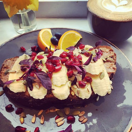 breakfast doorstop: a thick slice of wholewheat molasses toast, Freda's sea-salt peanut butter, banana and pome seeds. Let the day begin...