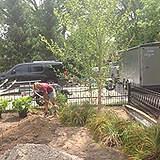 Staff Digging_Grand Haven Garden House.p