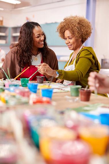 two-mature-women-attending-art-class-in-