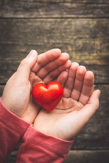 child-hold-a-red-heart-in-their-hands-L3