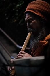 Blowing a Shakuhachi