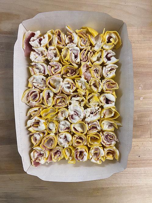 rosette del re besciamella, prosciutto cotto e formaggio grana