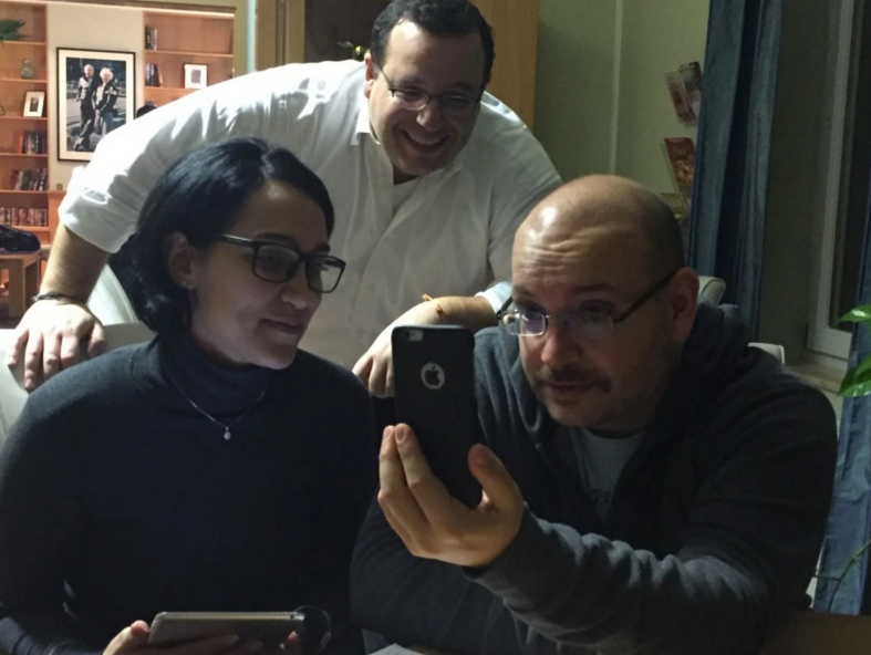 Jason Rezaian, along with his wife, Yeganeh Salehi, and brother, Ali, call family members back in California over Skype. (The Washington Post)