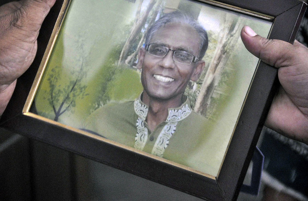 A photograph of Rezaul Karim Siddiquee, a professor who was killed in Rajshahi, Bangladesh, on Saturday. Credit Md. Abdullah Iqbal/Agence France-Presse — Getty Images