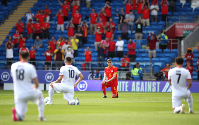 Wales' Chris Mepham takes the knee prior to their game against Albania on Saturday. Picture: PA