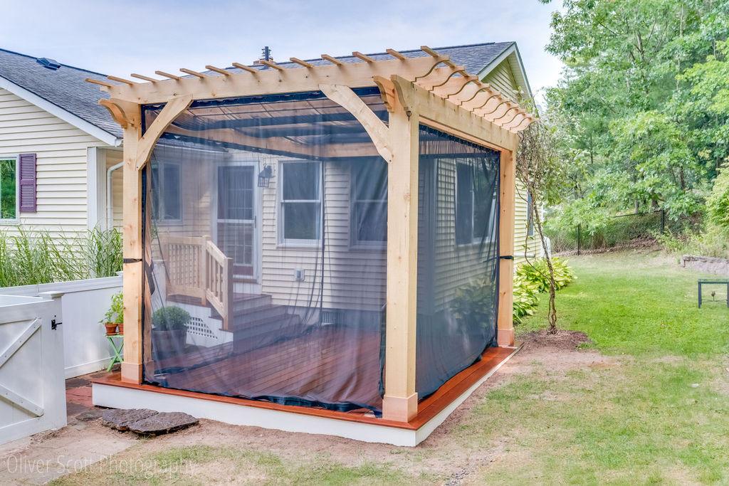 custom pergola & deck with screen curtains