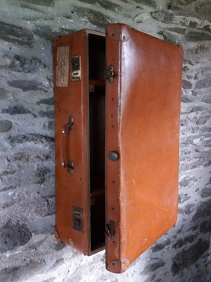 repurposed vintage suitcase wall cabinet with shelves
