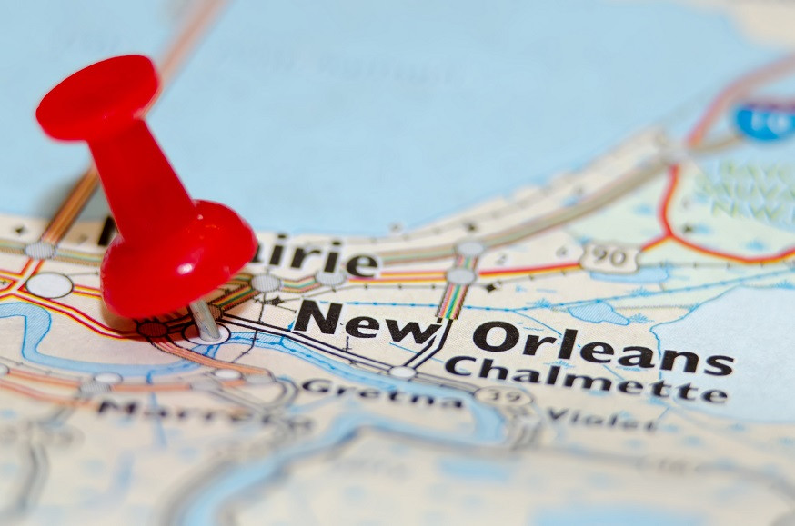 A pin pushed into a map near New Orleans.