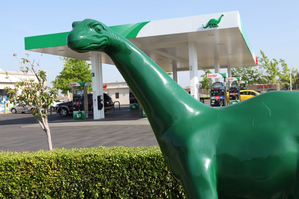 A Sinclair gas station with its iconic green dinosaur.