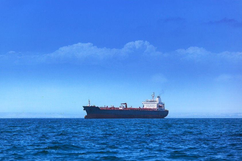 An oil tanker travelling off of the coast.