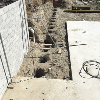Block wall and pile holes