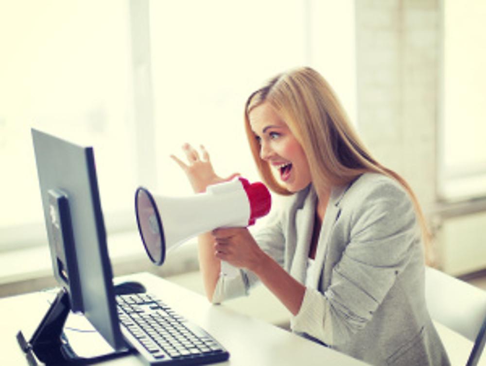 crazy businesswoman shouting in megaphone
