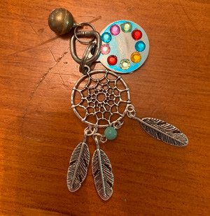 Create a hanging trinket from a pet tag