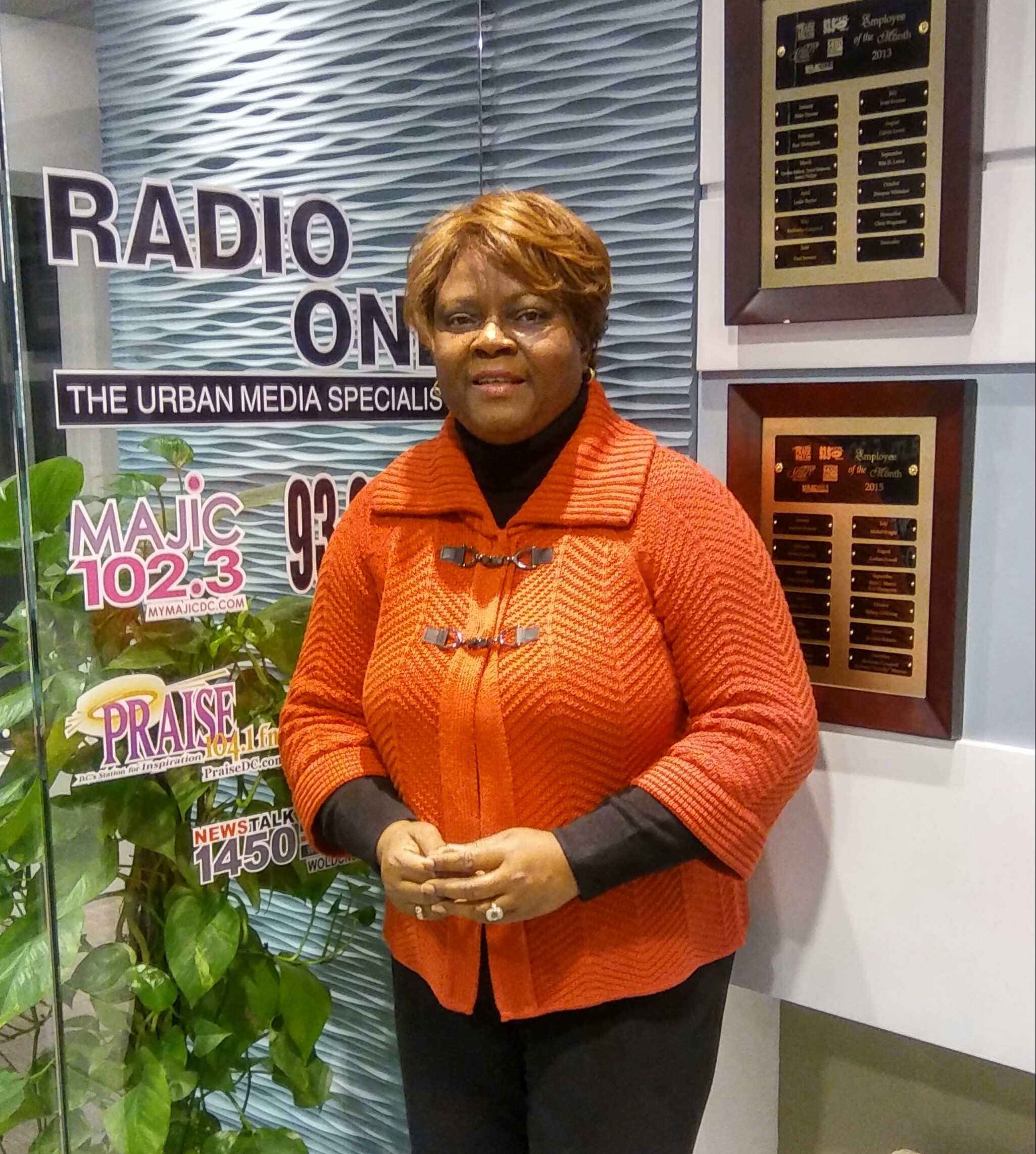 Paula standing at glass sign Radio One