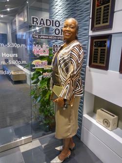Paula friend standing Radio One glass