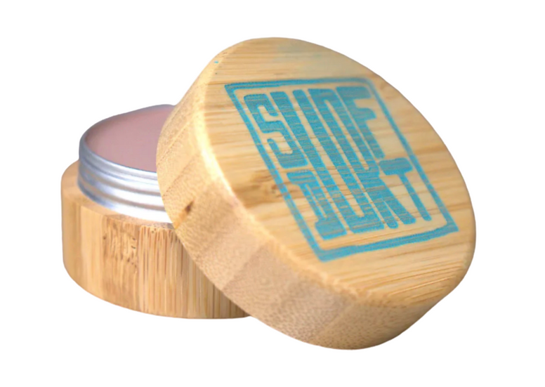 SURFDURT SUNSCREEN. LIMITED EDITION TEAL TOP. SPF 30. NEUTRAL TAN COLOR.