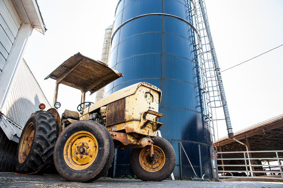 Image of tractor in front of a silo.